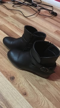 Pair of black leather boots Virginia Beach, 23464