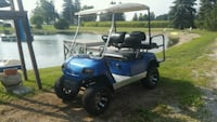 blue and white golf cart Defiance, 43512