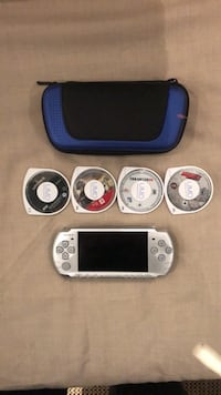 PSP + 3 games 1 Film, will need charger  Burlington, L7R 1W4