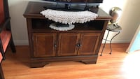 Brown wooden tv stand with flat screen television Glendale, 91206