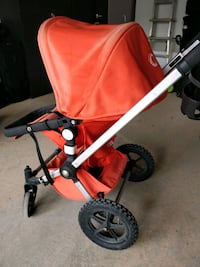 baby's red and black stroller Bradford West Gwillimbury, L0G