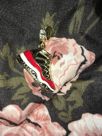 red and white gold-colored shoe keyholder Toronto, M1L 3E1