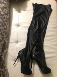 pair of black leather almond toe stiletto thigh-high boots Los Angeles, 90027
