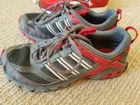 pair of gray-and-red Adidas running shoes