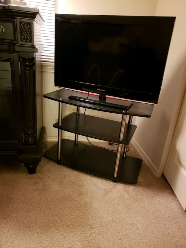 Samsung TV and the TV stand  18dbfda5-f8ff-4f98-877e-eef39d355460
