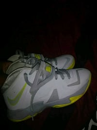 pair of gray-and-green Nike basketball shoes Texas City, 77591