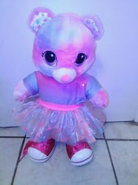 pink and blue teddy bear wearing tutu dress
