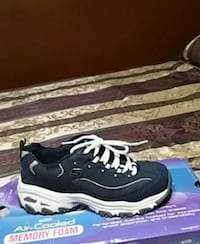 pair of navy blue-and-white skechers. New use once too small for me San Antonio, 78242