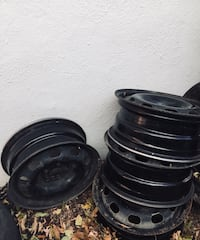 4 black bullet hole car wheels. They are almost like brand new.  I just don't need them anymore. They are fitting 195/65R15. Feel free to text. Calgary, T2K