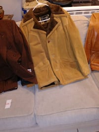 Vintage leather coats/ old magazines, posters