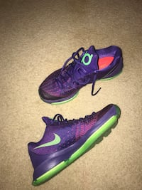 Pair of purple-and-green nike running shoes Falls Church, 22042