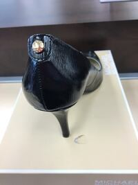 unpaired black Michael Kors leather heeled sandal with box