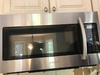 Samsung stainless steel over the stove microwave 264 mi