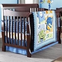 Monsters baby crib, mattress and bedding + free matching musical Burnaby, V5C 6S6