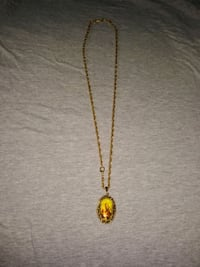 Gold chain and religious Mary locket pendant necklace