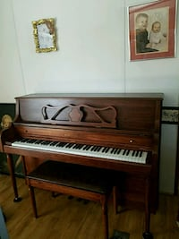 brown wooden upright piano with chair Lexington, 29073