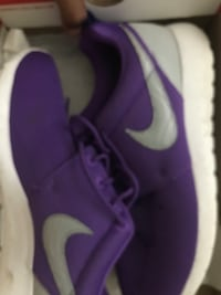 Pair of purple nike basketball shoes