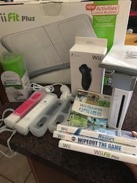 Wii Game Console including Wii Fit Plus Board.  Also includes several nunchucks and games Phoenix, 85023
