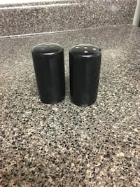 Two black salt and peppers jar