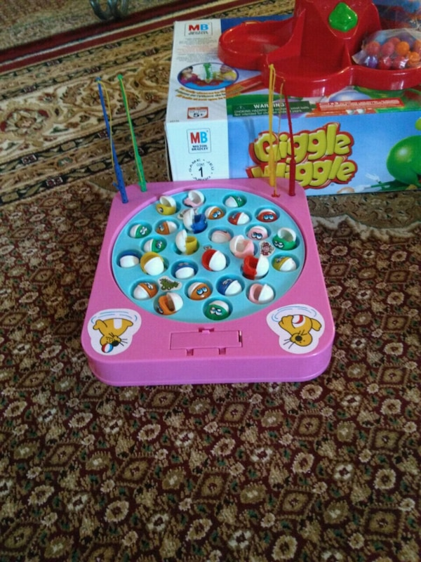 pink and purple Vtech learning toy