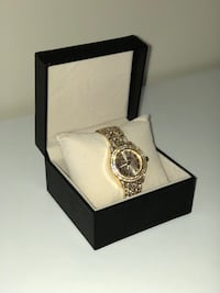 Round gold analog watch with gold link bracelet Dallas, 75287