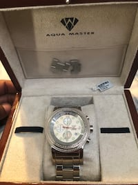 round silver chronograph watch with silver link bracelet in box Norfolk, 23508