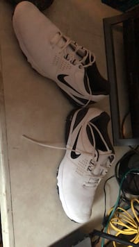Pair of white-and-black nike golf shoes Des Moines, 50315