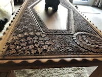 Beautiful hand carved coffee table. Must be seen to really appreciate it. Calgary, T3C 3T6