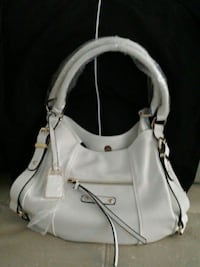 Brand new purse still has wrapping on it  Abbotsford, V2T 5J4