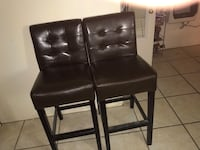 two black leather padded chairs Madison, 39110
