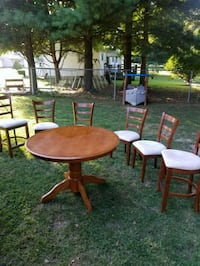 round brown wooden table with four chairs dining set Leesburg, 45135