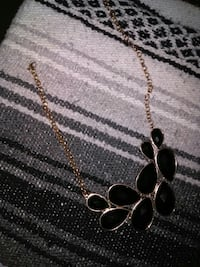 gold-colored and black Onyx bib necklace