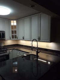 white and black wooden kitchen cabinet 63 km
