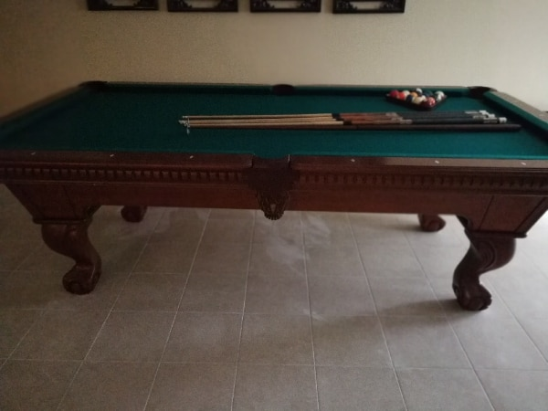 Black and green billiard table