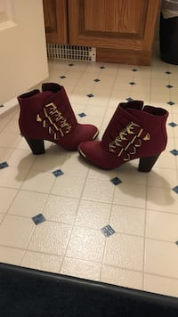 Pair of women's maroon buckled chunky-heeled booties Central Okanagan, V1Z