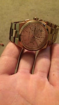 Round gold-colored analog watch with link bracelet. Made by micheal Kors    Windcrest, 78239