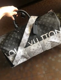 Louis vuitton keepall with free chirstian louboutin Key chain