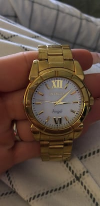 round gold-colored framed Invicta Angel analog watch with link band Vancouver, V6H 1Z8