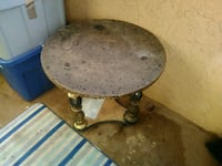 round brown wooden table with black metal base Albuquerque, 87109