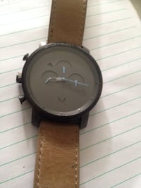round brown analog watch with brown leather strap