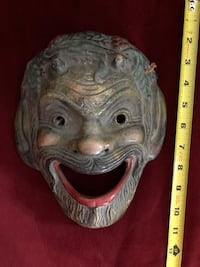 Wall Mask -made in Greece.  Heavy.  Might be made of resin.