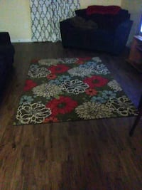 black, red, and green floral area rug Weslaco, 78596