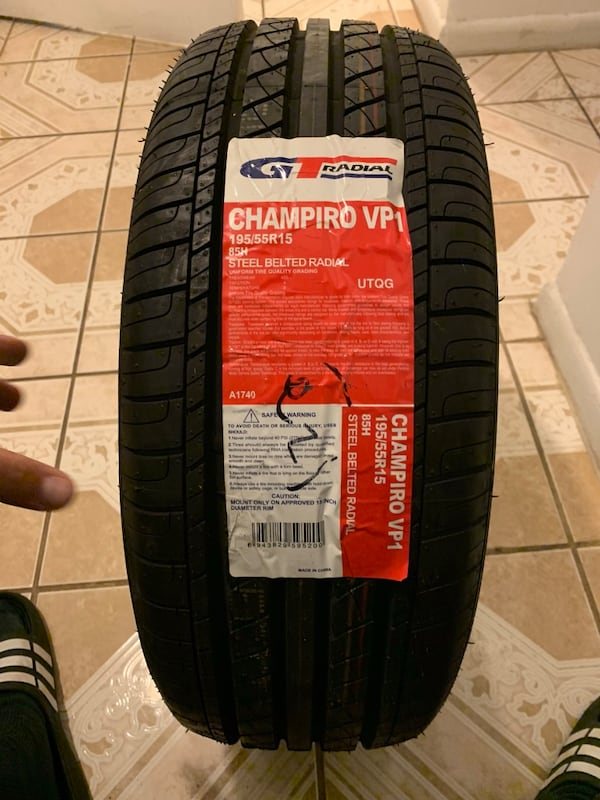 Black and red car tires 40dc0a0d-d6e6-4d0e-b012-795e24fc1e68