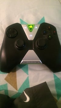 Black and silver shield game controller