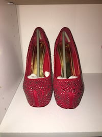 Pair of red studded platform stilettos