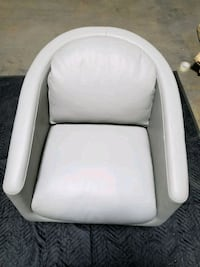 white leather padded chair with gray metal base New York, 10474