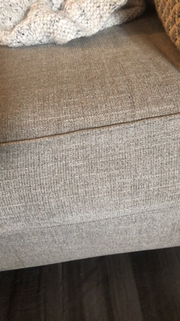 Ashley Furniture 9' three seater couch great condition 85d297bd-8317-4bf8-be67-b22148ffd2c1