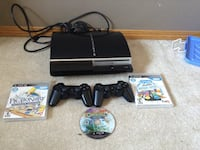 black Sony PS3 slim console with controller and game cases Calgary, T3K 4Y5