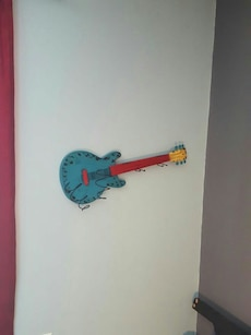 blue and red guitar wall decor