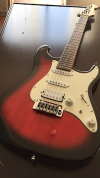 Red and white electric guitar  Richmond, V6X 1A2